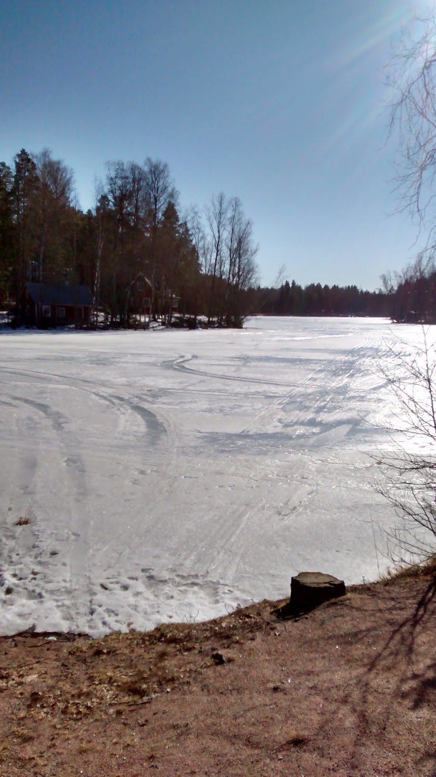Tire Marks On The Frozen Lake