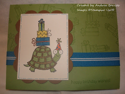 Green card base stamped with presents. Focal image is a turtle wearing a birthday hat and carrying a stack of presents on his shell.