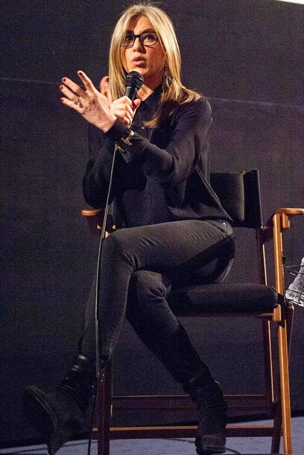Always stylish! Jennifer Aniston, 45, is seen wearing a dark shirt and jeans as she left little to imagination (Really smart!!) with her speaking skill during her attendance at American Cinematheque screening in Hollywood on Wednesday, November 19,.2014.