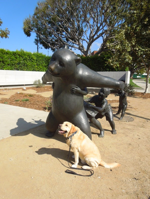 Labrador admires The Game bear sculpture West Hollywood