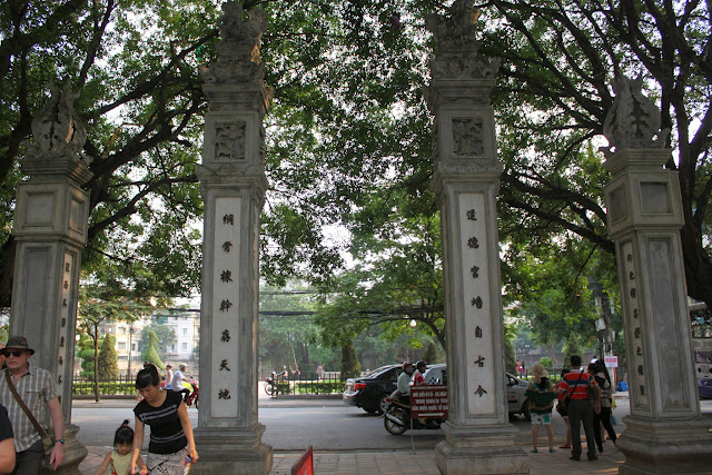 In front of the main gate of Temple of Literature, there are four tall pillars facing the main street in Hanoi, Vietnam