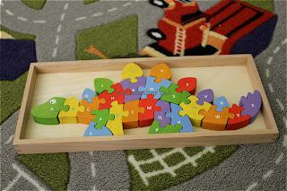 dinosaur wooden puzzle in storage box