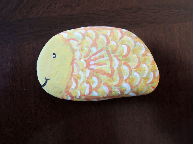 Painted fish stones