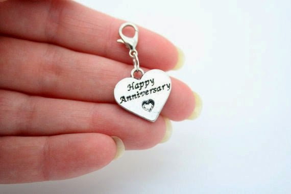 https://www.etsy.com/listing/183480612/stamped-happy-anniversary-charm?ref=favs_view_4