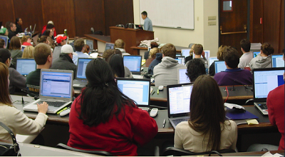 Photo of a classroom of students using their laptops to take notes and do their assignments