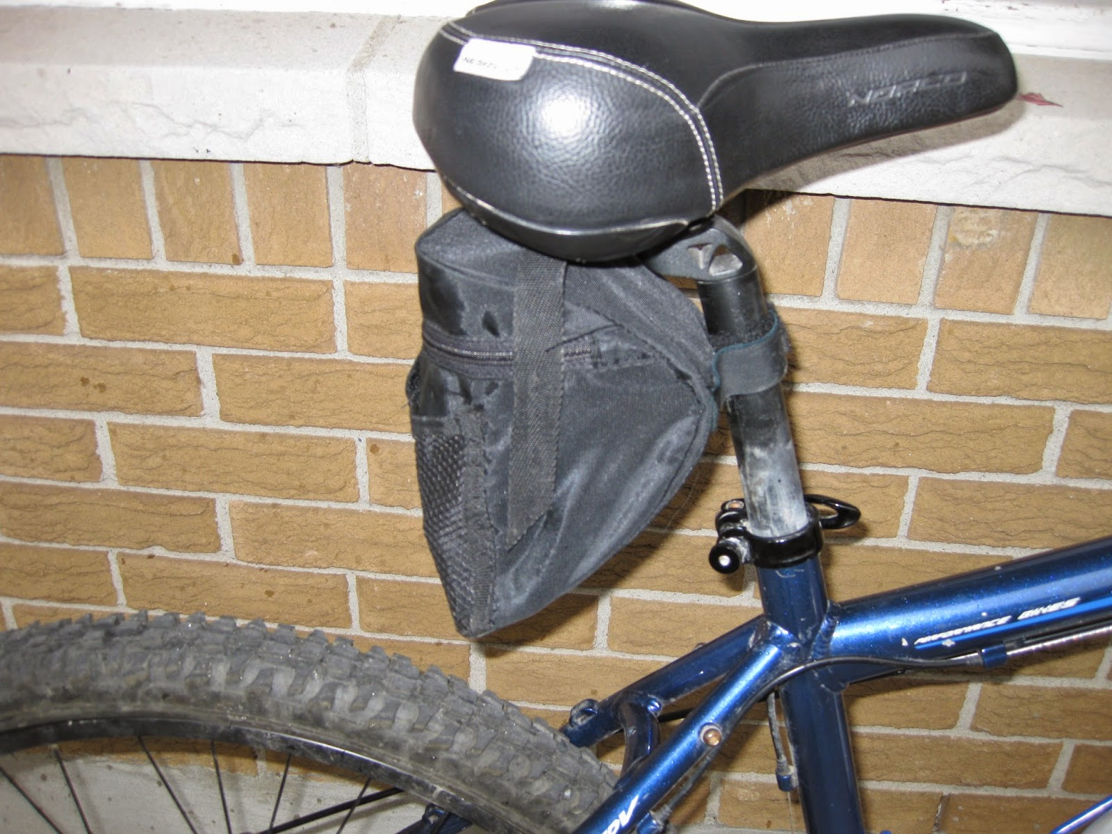 An old bicycle saddlebag that's seen better days.