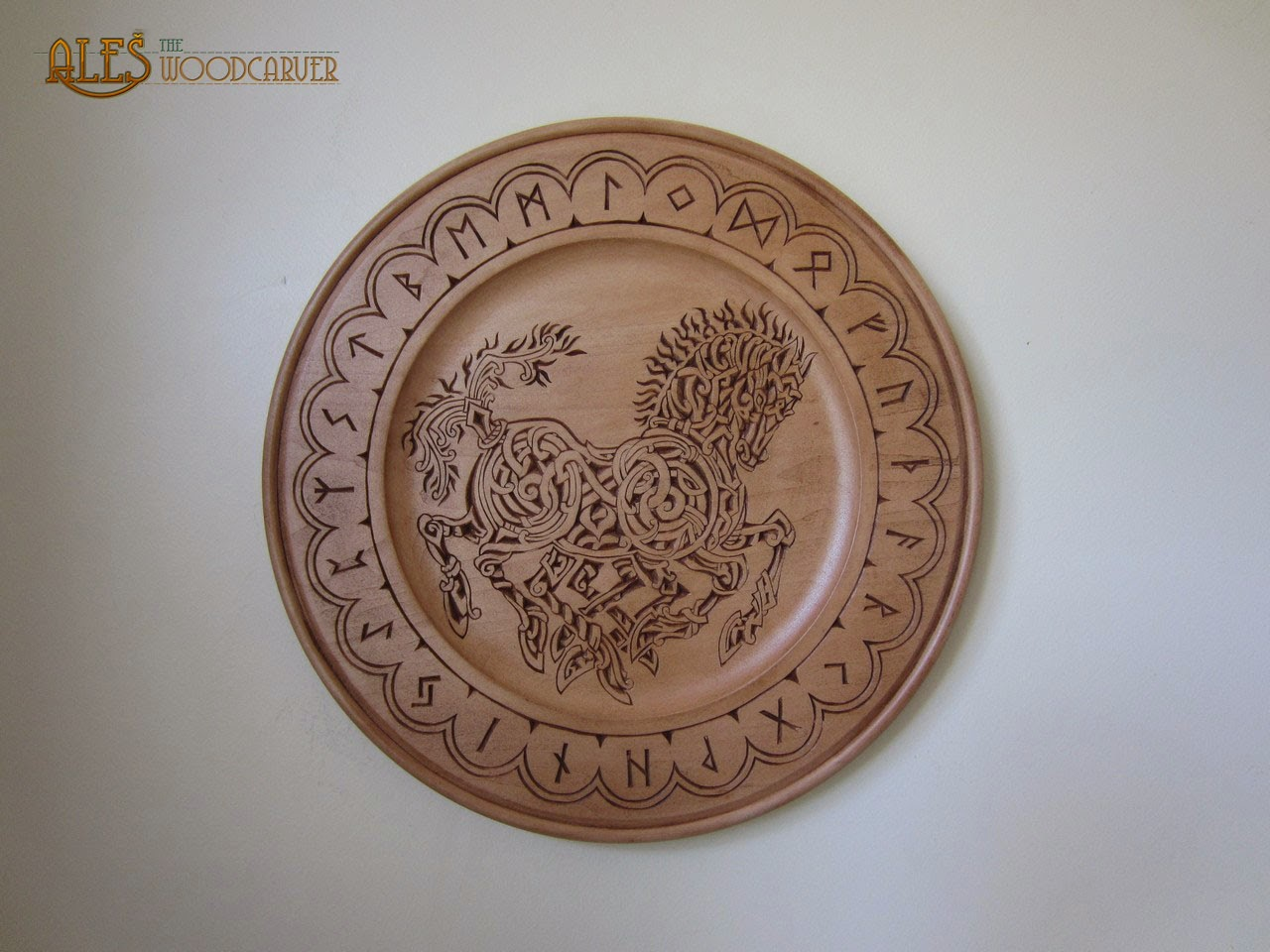 Ales the woodcarver sleipnir with futhark chip carving