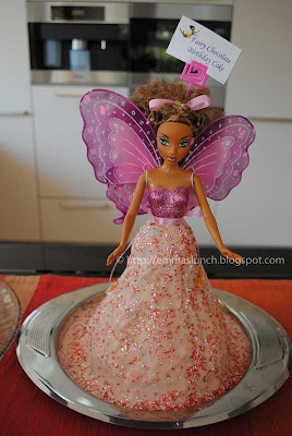 Fairy shaped birthday cake with doll