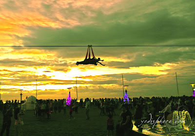 Two riders riding the zipline against the sunset at SM Mall of Asia