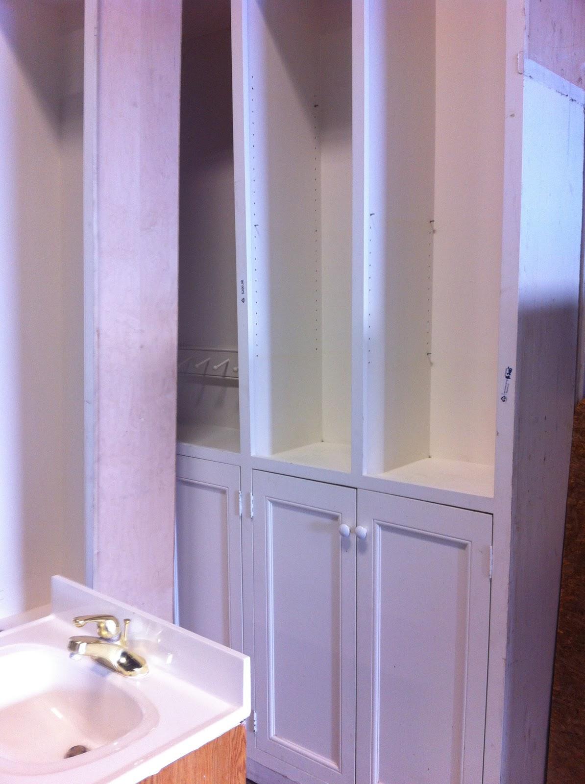 tre sorelle cottage: Entry way storage cabinet retrofit