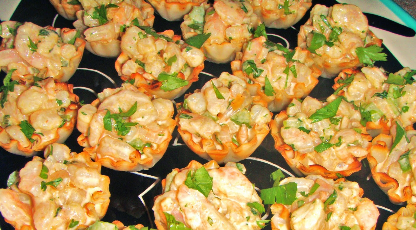 mango curry shrimp salad in mini phyllo cups