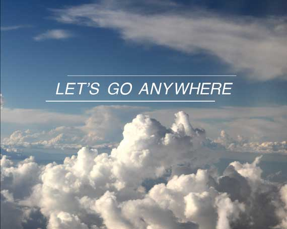 view above the clouds with the text lets go anywhere