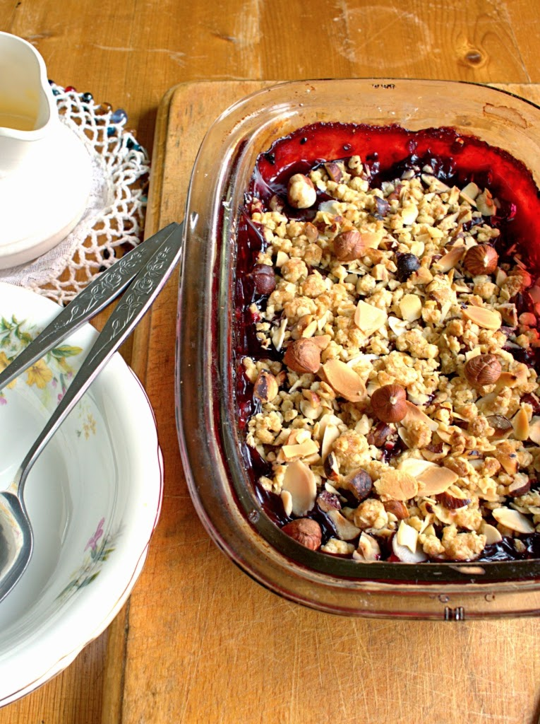 Wine roasted Blackberry Crumble with buttery oats, hazelnuts and almonds. Also known as a crisp, crumble or buckle.