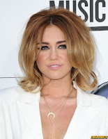 Miley Cyrus in Little White Outfit and showing her long legs at the 2012 Billboard Music Awards