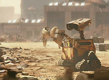 WALL-E wandering a barren landscape animatedfilmreviews.filminspector.com