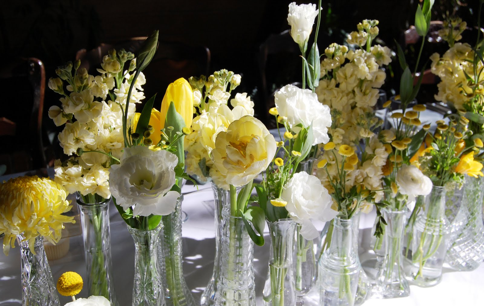 Blossom sweet mikaela at la caille sneak peek collection of twenty vintage bud vases lining the center of the table filled with various blooms mirroring the brides bouquet we also placed bud vases reviewsmspy
