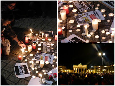 "Kerzen, Karikaturen und ""Je suis Charlie""-Blätter vor dem Brandenburger Tor"