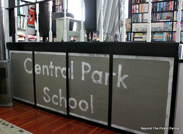 schoolhouse, sign, handlettered, sliding screens, covering up a TV, paint, library,http://bec4-beyondthepicketfence.blogspot.com/2016/01/schoolhouse-update.html