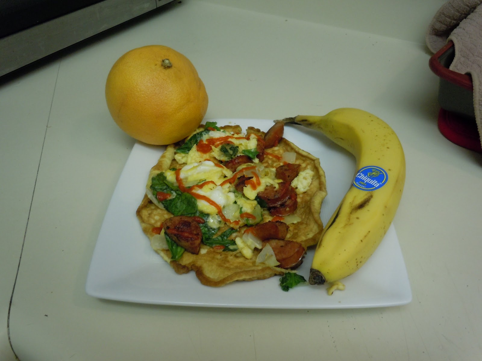 Savory coconut pancakes topped with egg scramble and a side of fruit