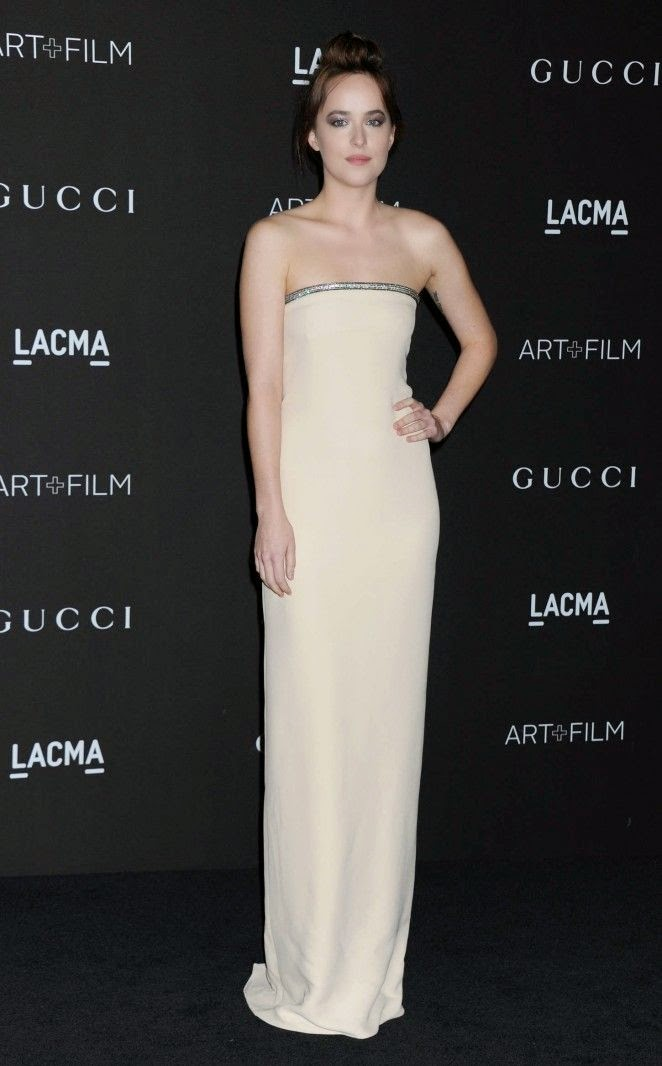 Dakota Johnson put her masterful styling skills to good use as she made her way to LACMA Art + Film Gala at Los Angeles, USA on Saturday, November 1, 2014. Struggled to contain her anatomy in a cream strapless of long dress, the 25-year-old appeared to be giving her grief at some point. . . . .Thanks to the logarithmic derivative from father, Dakota Johnson and mother, Melanie Griffith.