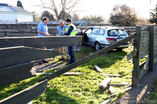 "A car driven by a male, with passengers, smashed through a 10x 6x1"" timber fence of the Stortford Lodge Saleyards in Southampton St West, Hastings, before coming to a halt after crashing through another pen. Police, St John Ambulance attended. photograph"