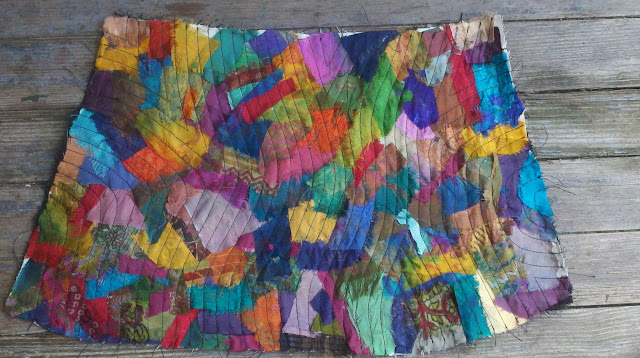 one side of bag with recycled silk pieces after I quilted it
