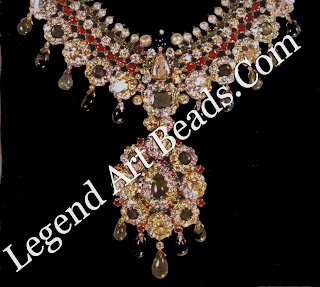 A faithful European interpretation of a formal Indian necklace, featuring diamonds, pearls, and cabochon emeralds and rubies set in gold. It was made by the New York branch of Van Cleef & Arpels in 1965.