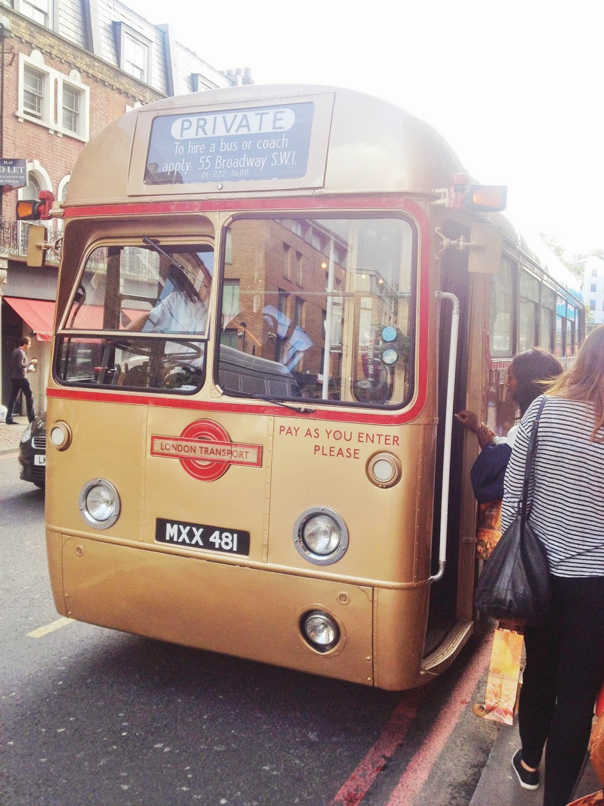 Vintage gold bus in London
