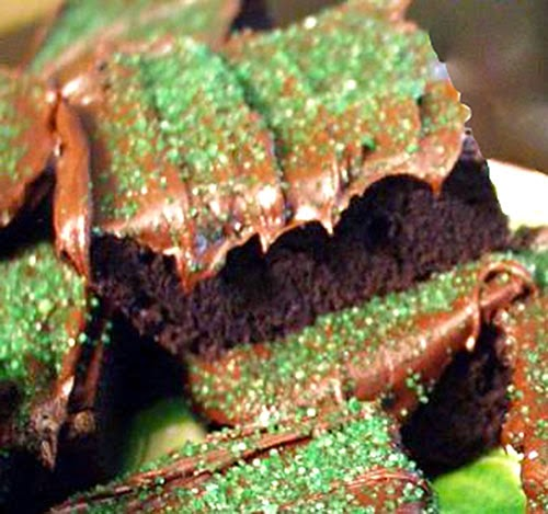 Guinness Brownies: Rich chocolate and guinness brownies topped with a guinness and chocolate frosting and decorated with green sugar crystals for St Patrick's Day