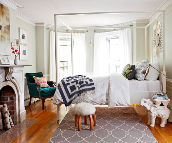 The Barely Green Walls, White Architectural Details And A Palette Of Grays  In This Bedroom Allow Personality Filled Accents To Truly Shine.