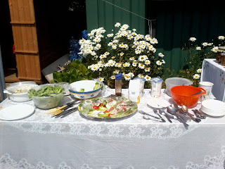 The salads were laid out on a table for people to help themselves. It wasn't planned the the flowers in the planter were set in the middle but what a lovely addition to the table!