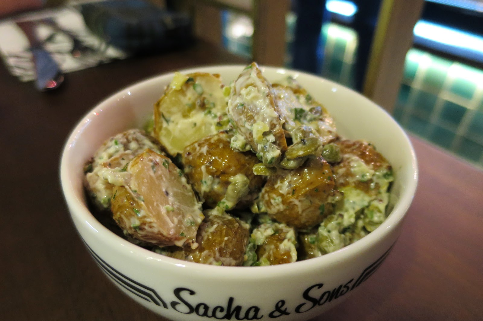 Try the potato salad with capers. It's actually pretty good.