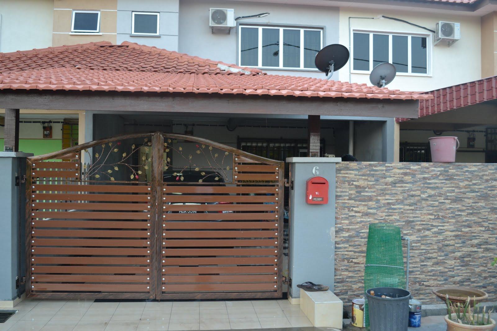 ni bahagian depan rumah dari luar... senang cakap sume design tiles pagar and tembok umah mr.joe yang buat and berdasarkan faktor2 dan ciri keselamatan ... & hAiSHaIc@T ::: 70% - 85%