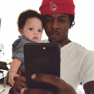 Runtown with his son