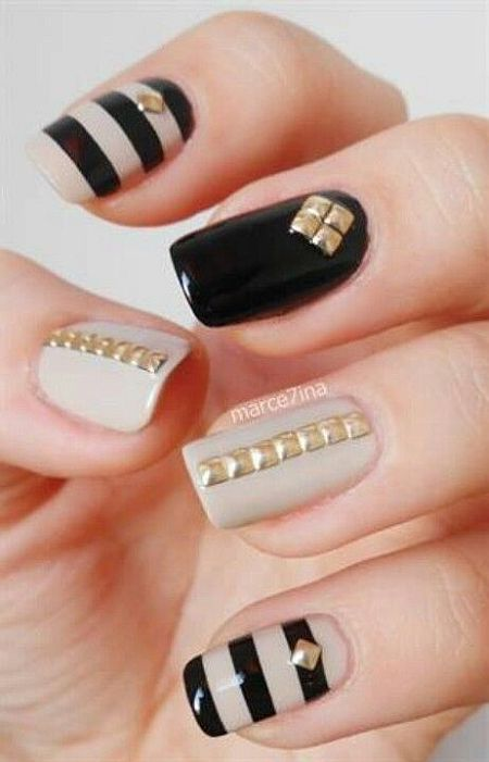 glamorous nail art with beige, black, gold and stripes