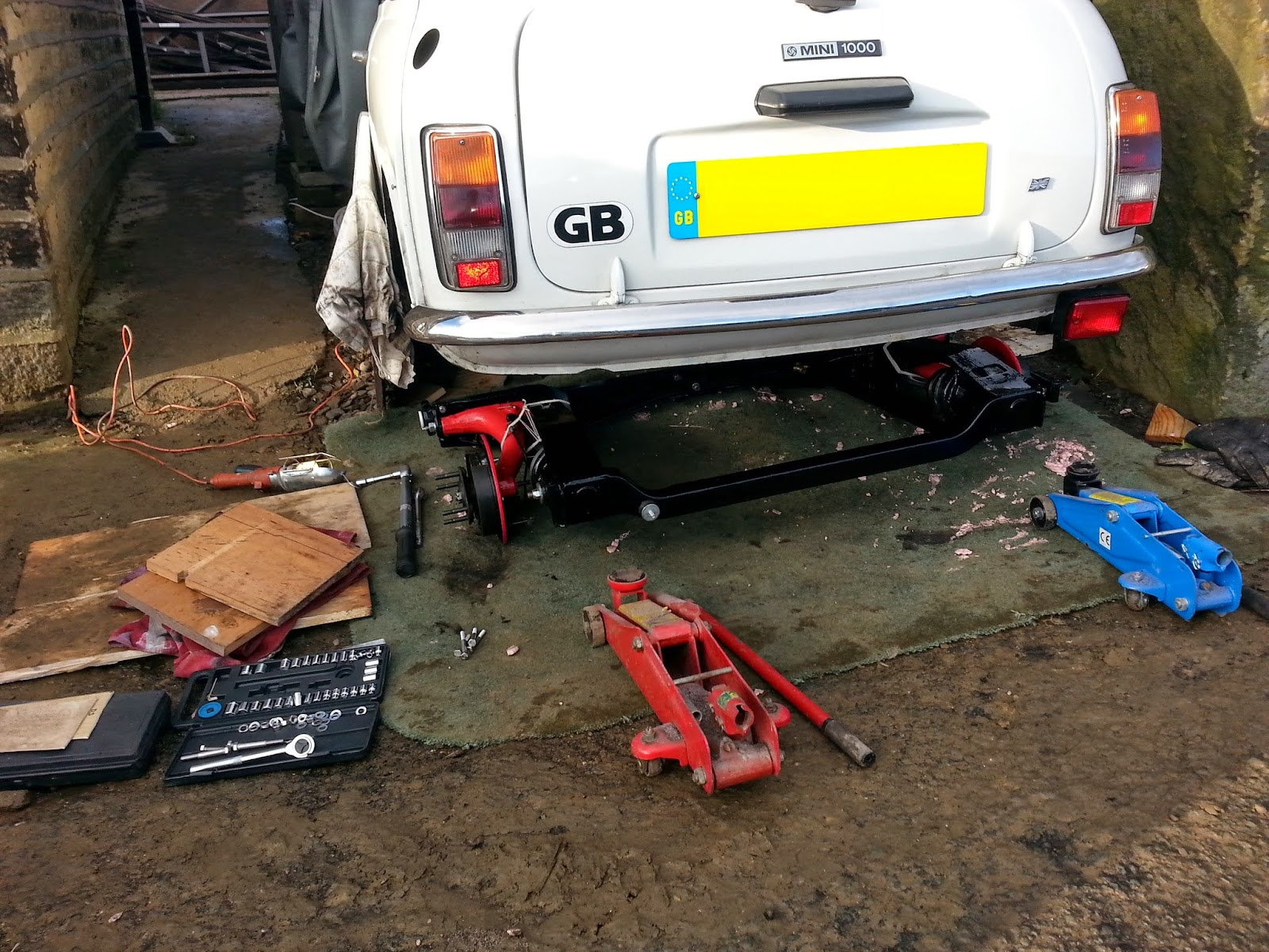 And the engine mounted to the subframe with exhaust system in place - Using Cloths Over A Small Piece Of Wood I Lifted The Subframe Onto The Jacks There Is A Balancing Point Front To Back Where The Subframe Will Sit Without