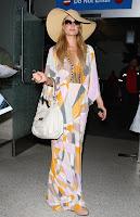 Paris Hilton wearing a 70s dress