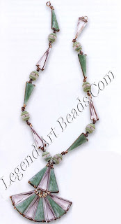 """A very geometric French necklace, revealing Art Deco's progression toward a more Cubist look dating from the very end of the 1920s. Clear glass and """"Peking glass"""" (faux jade) are set in silver frames and interspersed with Peking glass and cut. crystal rondelles. £200-300 ($34o-51°)"""