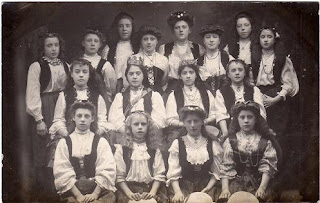 Vintage postcard of girls and women in costume