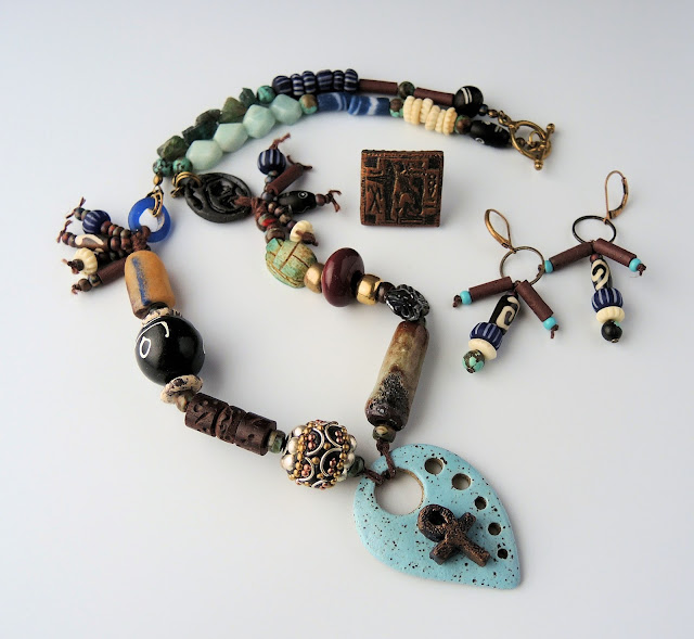 Necklace, earrings and ring by Lennis Carrier of Windbent