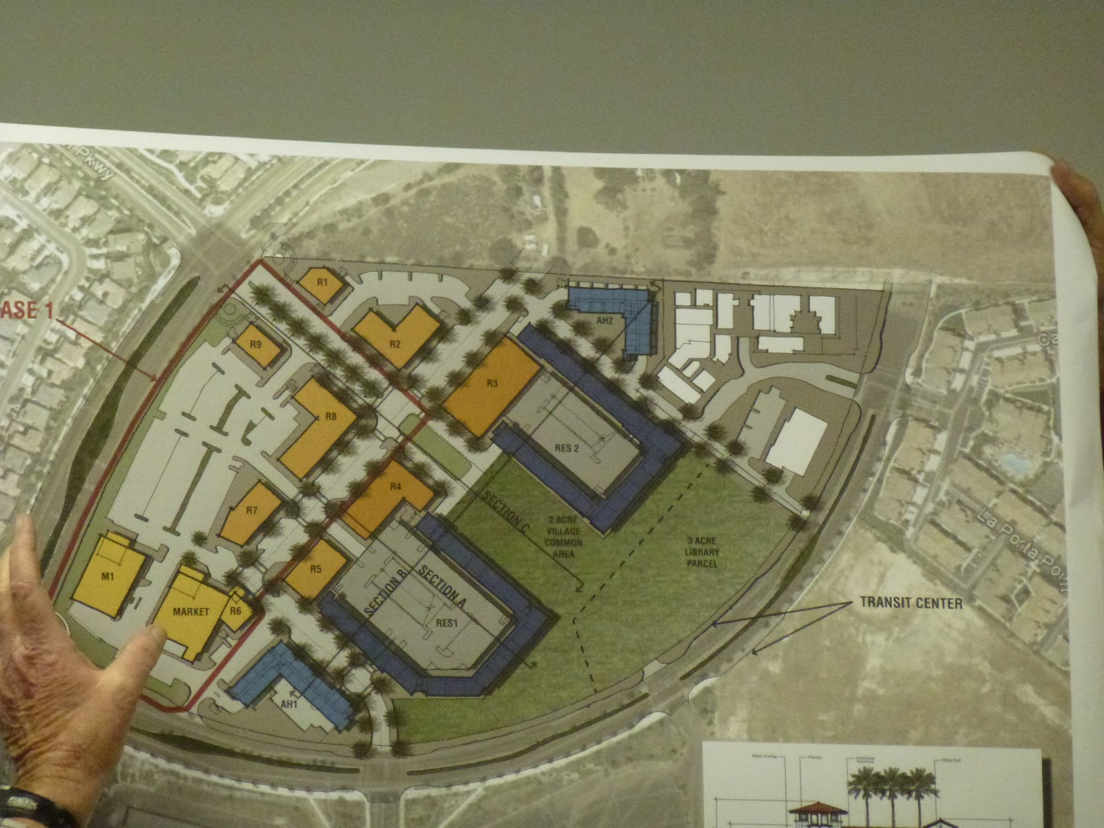 the first photo above that i am posting is the overall site plan the retail is in yellow and orange i am not sure of the difference in significance