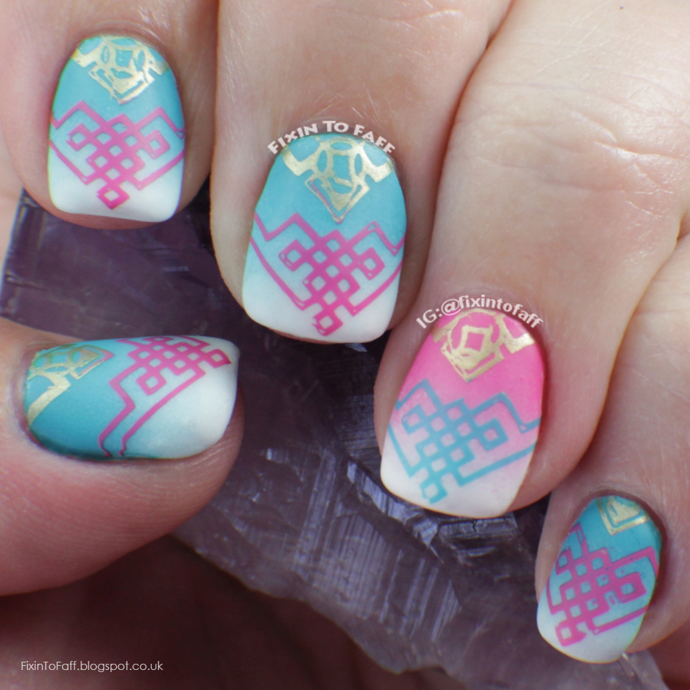 Pink, white, and aqua gradient nail art, stamped with tribal V-pattern.