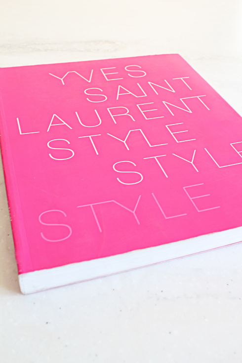 Its also nice that the cover is all hot pink, which is great for those of us who like pretty books! You can buy your copy of Yves Saint Laurent Style