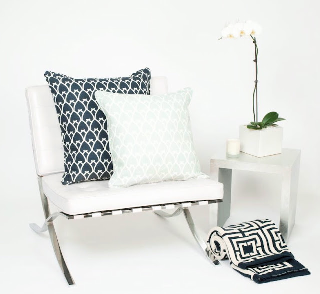 Mies van der Rohe white leather Barcelona chair COCOCOZY arch pillows navy blue seafoam sea foam green modern decor
