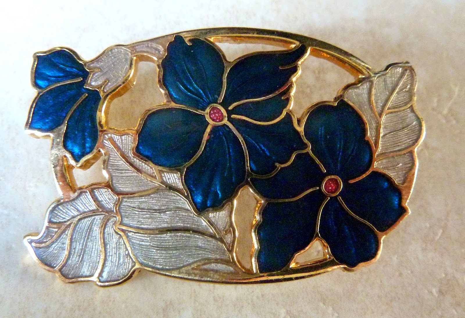 http://www.kcavintagegems.uk/fish-and-crown-cloisonne-enamel-blue-floral-brooch-415-p.asp