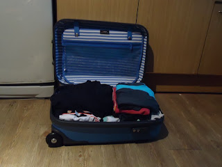how to pack dress pants in a suitcase