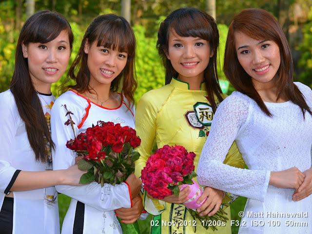 people, groupshot, street portrait, Vietnam, Hanoi, Vietnamese women, smiling, posing, áo dài, silk, roses