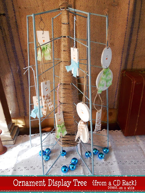 Upcycling an old cd holder as a tree for displaying ornaments