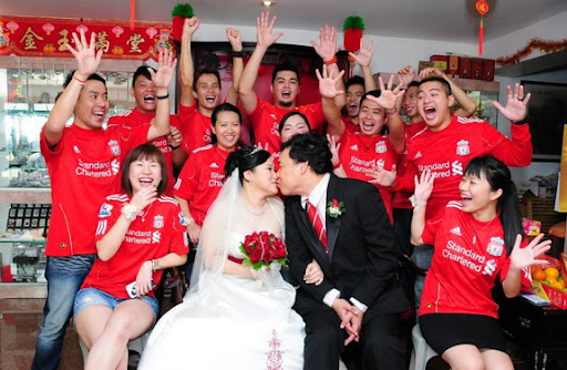 The happy newlywed Liverpool fans take pictures with fellow Kopites