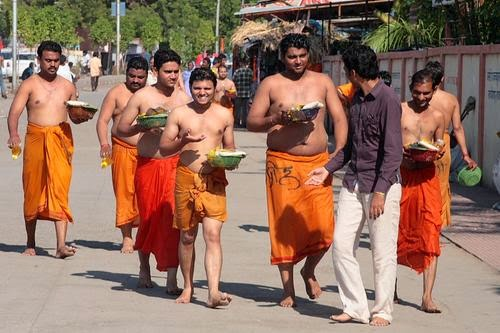devotees going to temple with their guide